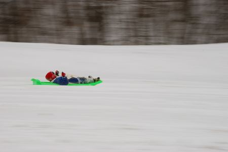 boy is sledding photo
