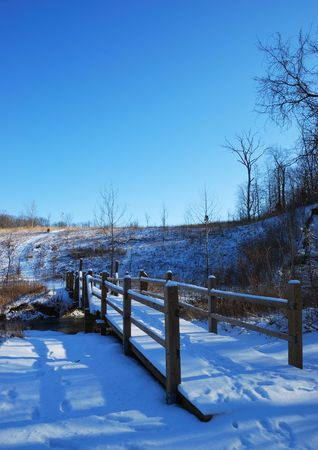 covered bridge: snow covered bridge and the hill
