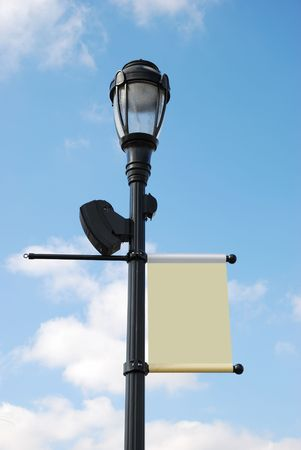 sign post: streetlight with blank banner