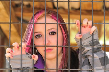 jail: girl behind bar Stock Photo