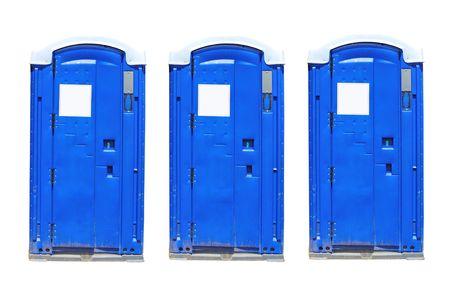 three portable toilets