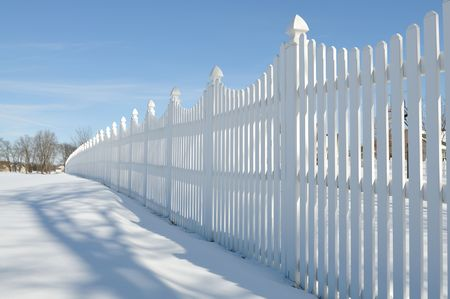 white fence on the snow Stock Photo - 6411939