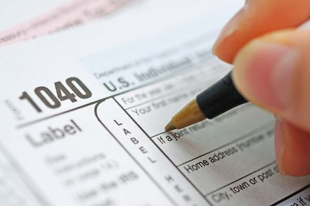 net income: writing tax return Stock Photo