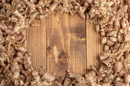 Large wood planer shavings background. Wood shavings of different sizes from woodworking.