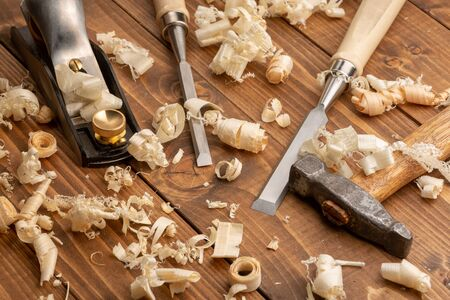 Chisel and small block plane with wood shavings