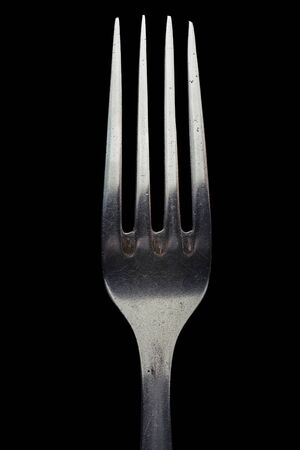 Fork close up. Isolated image on a black background. Stock Photo