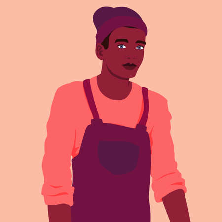 Portrait of a young man in a work apron