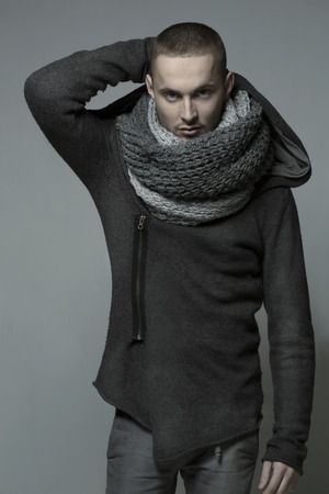 Young handsome man in a grey wrap, shawl photo