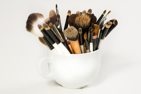 Professional makeup brush in a white cup photo