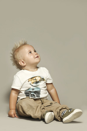 Cute blond kid looking up photo