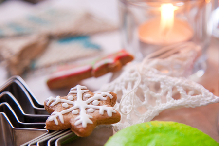 Cookies in the form of a snowflake next to the Christmas decorations-the star and the candle