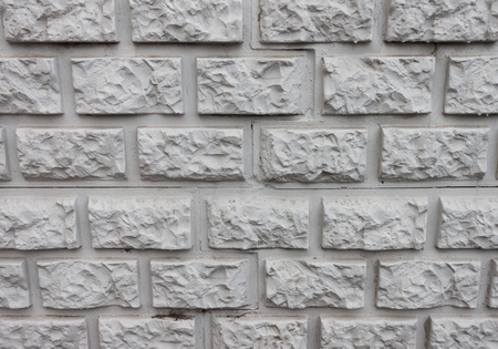 White wall for background and texture of the brick relief