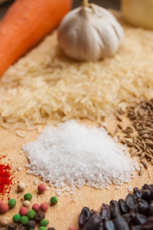 barberries: Products for cooking pilaf lie on a wooden background Stock Photo