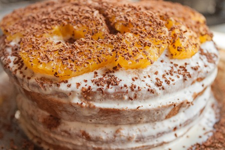 chocolate chips: Cake cream drizzled with chocolate chips and orange slices
