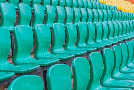 in the ranks: Ranks Colour plastic armchairs on stadium tribune in the open air Stock Photo