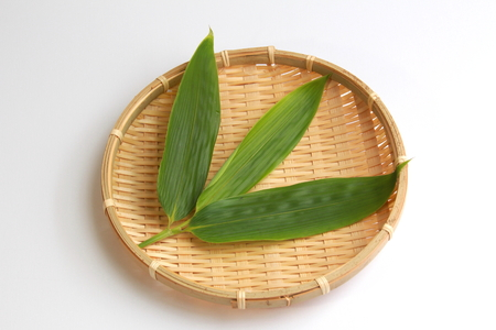 underlay: Arrange the bamboo leaves in a colander Stock Photo