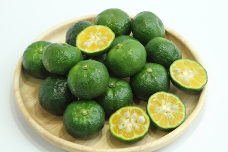 Citrus depressa (Taiwan tangerine, flat lemon, hirami lemon). Stock Photo