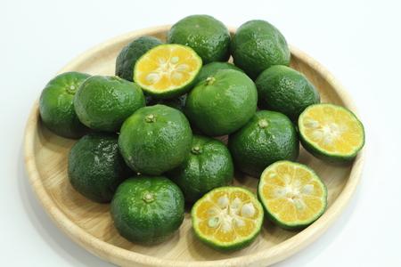 acidity: Citrus depressa (Taiwan tangerine, flat lemon, hirami lemon). Stock Photo