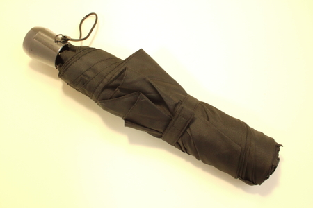 impermeable: Black collapsible umbrella Stock Photo