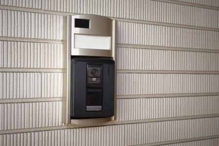 鍵穴、チャイム、インターホン、玄関ドア 写真素材
