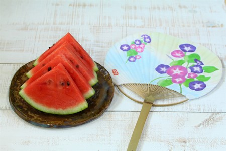 Summer image, watermelon and a fan