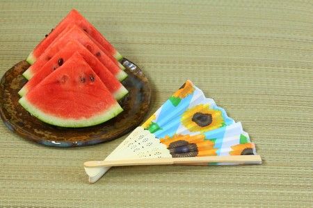 Summer image, watermelon and folding fan