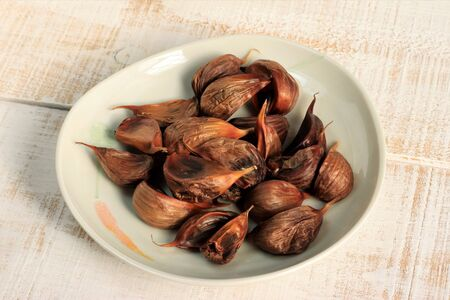 Traditional food black garlic Фото со стока