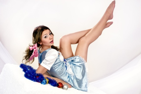 Maiden woman lies in a raised foot photo