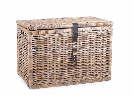 to clasp: wicker thatched basket with leather clasp on a white background. Stock Photo