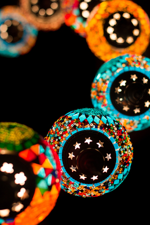 market bottom: Mosaic east style lanterns on dark background. Closeup. View bottom. Wallpaper for phone. Stock Photo