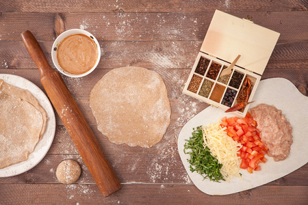 ingridients for cooking taco on wooden background.