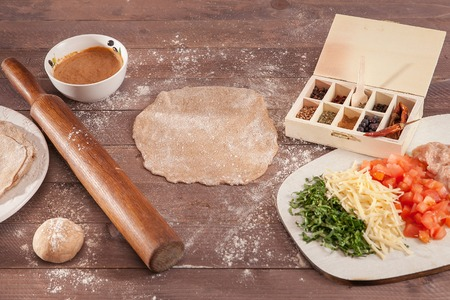 ingridients for cooking taco on wooden table.