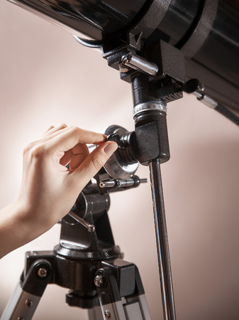 closeup of male hand setup black telescope 版權商用圖片