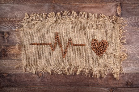 creative concept. cardiogram of coffee beans on sacking. 版權商用圖片