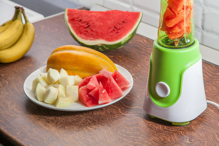 Blender with watermelon, melon and bananas.
