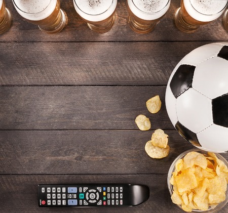 lasses of beer with snack and soccer ball on wooden. Copy space. Flat 版權商用圖片