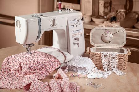 sewing box: sewing machine in work witn sewing box