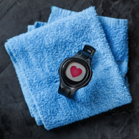 heart rate monitor on blue towel. closeup