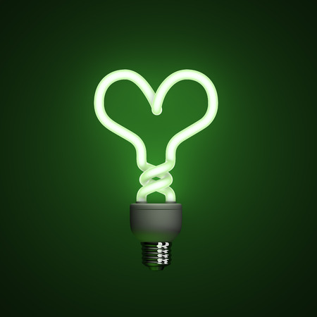 Energy saving compact fluorescent lightbulb, lamp on a green background with fine illumination