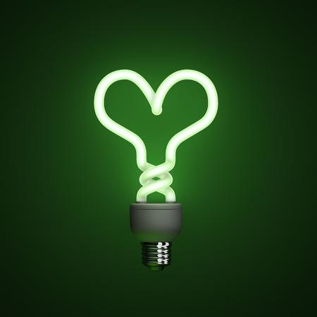 compact fluorescent lightbulb: Energy saving compact fluorescent lightbulb, lamp on a green background with fine illumination
