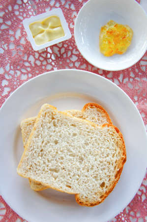 Breakfast on the table with bread and yam photo