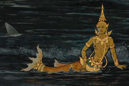 Thai mermaid pained, Thai art painted on wall in Buddhist temple photo