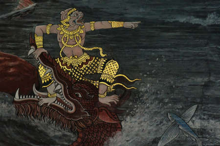 Monkey fight with a big monster in river, Thai art painted on wall in Buddhist temple photo