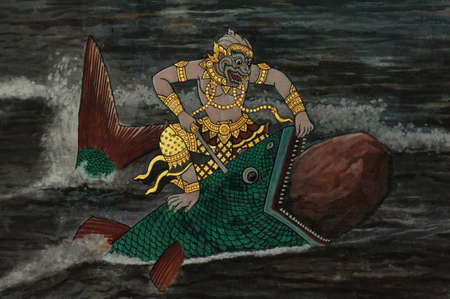 Monkey fight with a big fish in water, Thai art painted on wall in Buddhist temple photo