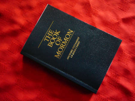 Book Of Mormon on red background