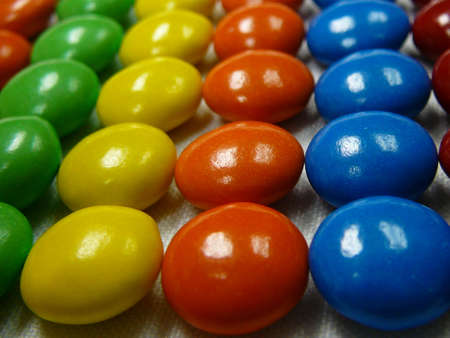 Candy coated chocolate candies arranged by color