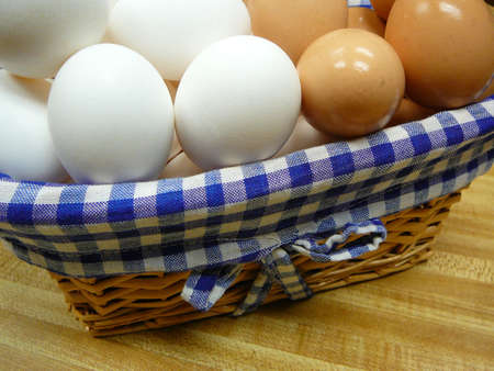 protien: Brown and white eggs in a basket.