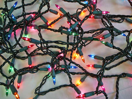 lighted: Tangle of Lighted Christmas Lights Stock Photo