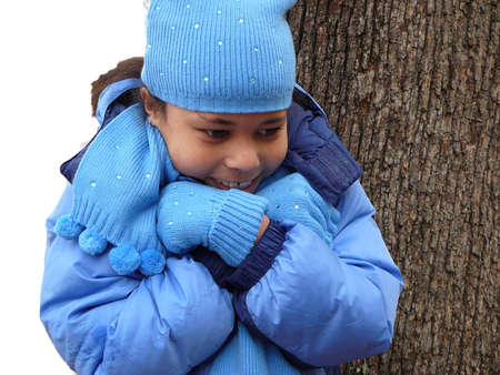 Child all bundled up but still cold Stock Photo