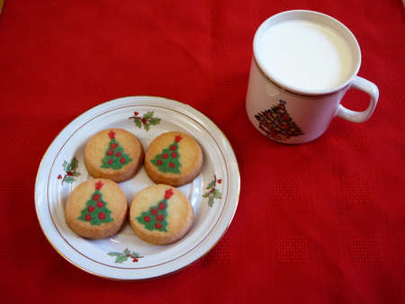 Christmas Cookies and cup of milk for Santa. photo
